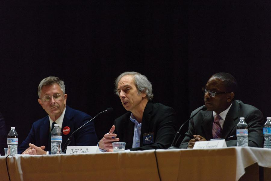 Mayoral candidates Mark Tendam (left), Jeff Smith (center) and Gary Gaspard (right) talk Thursday night at an election forum at Chute Middle School, 1400 Oakton St. The forum was intended to increase awareness about mayoral and aldermanic candidates ahead of the upcoming elections.