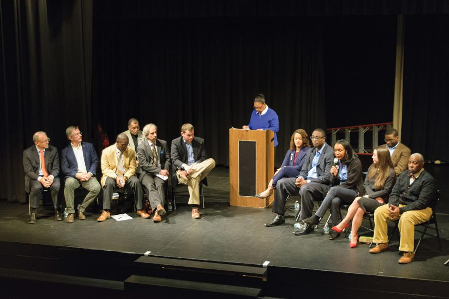 Candidates for mayor, city clerk and 5th Ward alderman sit onstage at a forum Thursday night. The candidates discussed affordable housing and property taxes, among other items, at the forum.