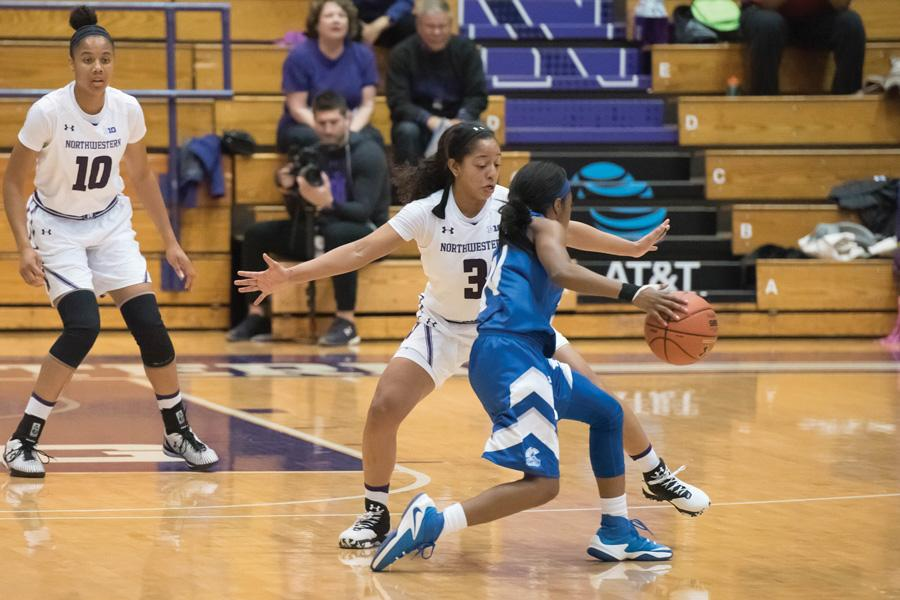 Ashley Deary guards a ball-handler. The senior guard became the Big Ten's all-time leader in steals but could not lift NU to a win Tuesday.
