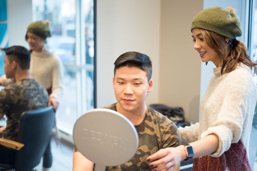 (Colin Boyle/Daily Senior Staffer)  A hairstylist at Steven Papageorge Salon, 1721 Sherman Ave., shows a customer his cut. A new Illinois law will require hairstylists to take a training course on identifying signs of domestic and sexual assault.