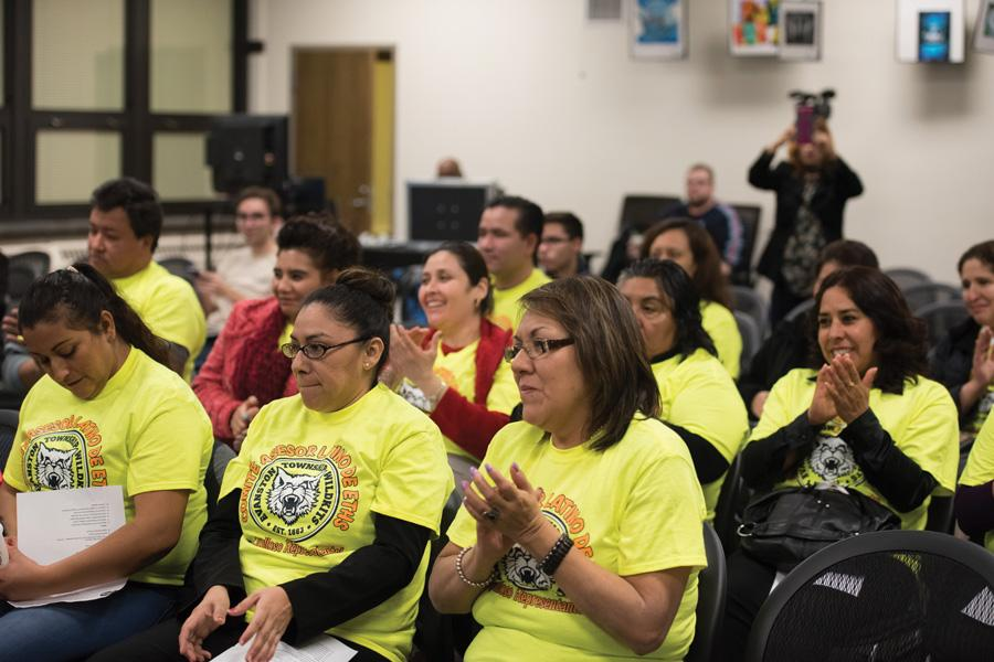 "(Katie Pach/Daily Senior Staffer) Parent volunteers from the Latino Advisory Committee at the Evanston Township High School District 202 board meeting. They gathered to show their gratitude to the board for passing the ""safe haven"" resolution."