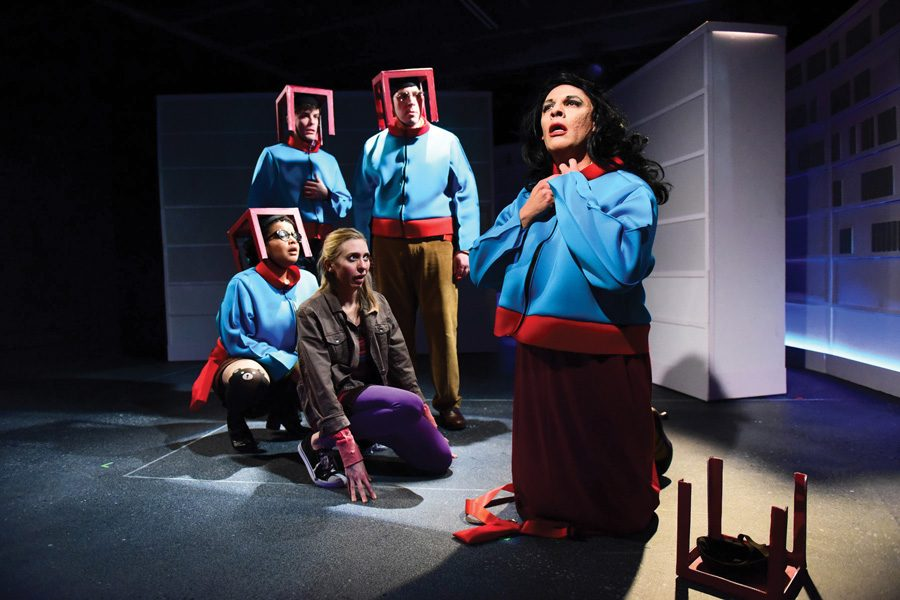 Characters in Psychonaut Librarians wear time-travel gear to enter into an alternate universe. The production will run through Feb. 12 at The Den Theatre in Chicago.