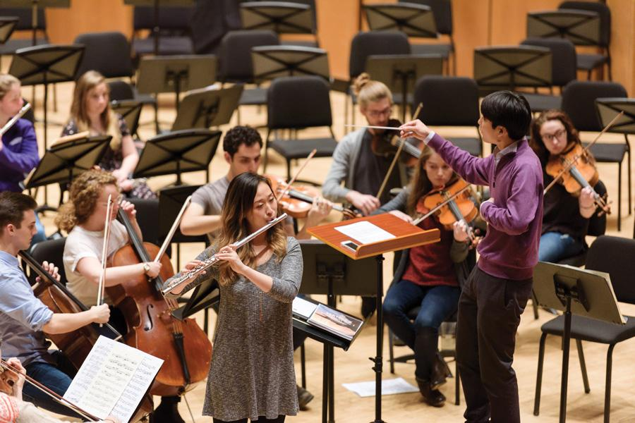 (Jeffrey Wang/The Daily Northwestern) Bienen graduate student Taichi Fukumura conducts Mahler's Symphony No. 1 as performed by the Accompianetta, an ensemble he created to give musicians more opportunities to play solos and accompaniments.