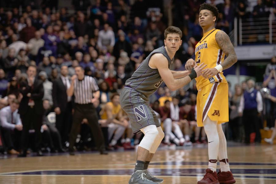 Bryant McIntosh plays defense. The guard's slow start has hurt Northwestern but provides the team with room for improvement.