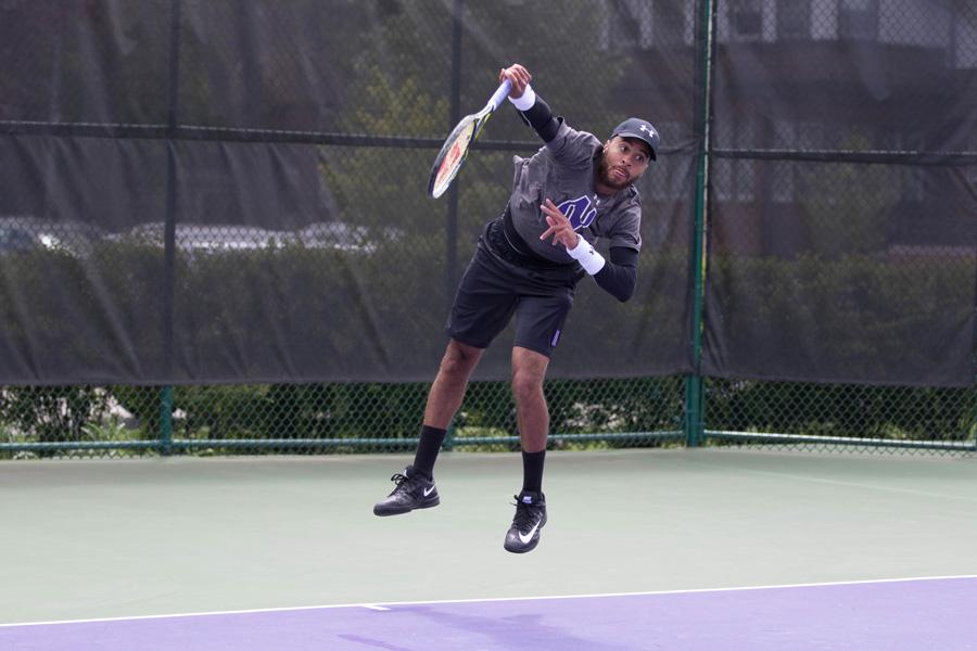 Sam Shropshire serves. The senior bounced back from a slow start to the season and helped lead Northwestern to two weekend wins.