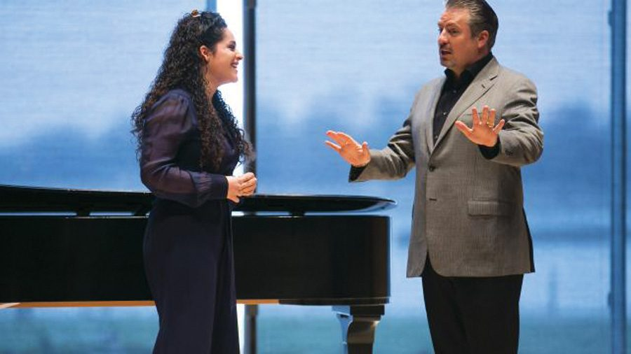 Opera vocalist Matthew Polenzani, right, teaches a vocal master class to one of four selected NU vocalists. This was Polenzani's second time teaching at Northwestern, and said he chose to return because of the high caliber of students he worked with last year.