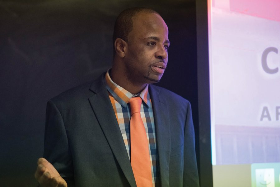 Eddie Willis, member of Black and Pink's Chicago branch, speaks to students about LGBTQ prisoners and the organization's penpal system. The event was hosted by the Queer Pride Graduate Students Association on Wednesday night.