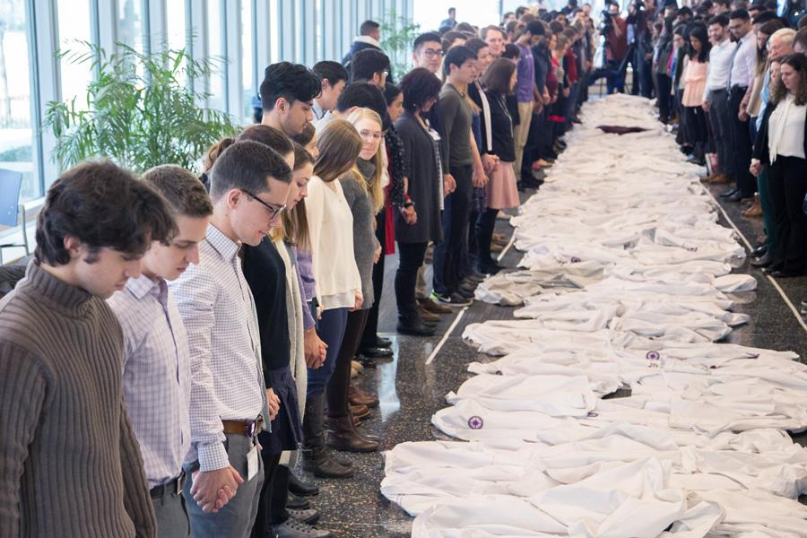 Feinberg students and faculty lay down their white coats in support of the Affordable Care Act. The demonstration was held in Chicago on Monday.