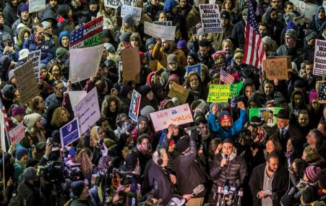 Demonstrators gather Sunday outside Terminal 5 of O'Hare International Airport to protest President Donald Trump's executive order on immigrants and refugees. Over the weekend, about 150 attorneys and at least 1,000 protesters gathered at the airport to help detainees gain entry.