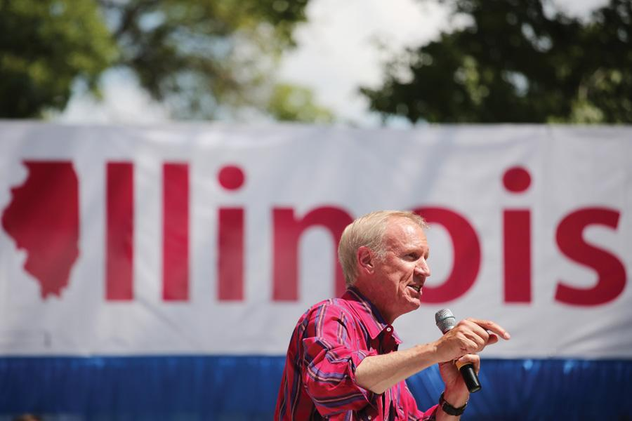 "Gov. Bruce Rauner speaks at the Illinois State Fair in Springfield in August. Rauner urged lawmakers in his ""State of the State"" address to cooperate in order to reach a ""truly"" balanced budget."