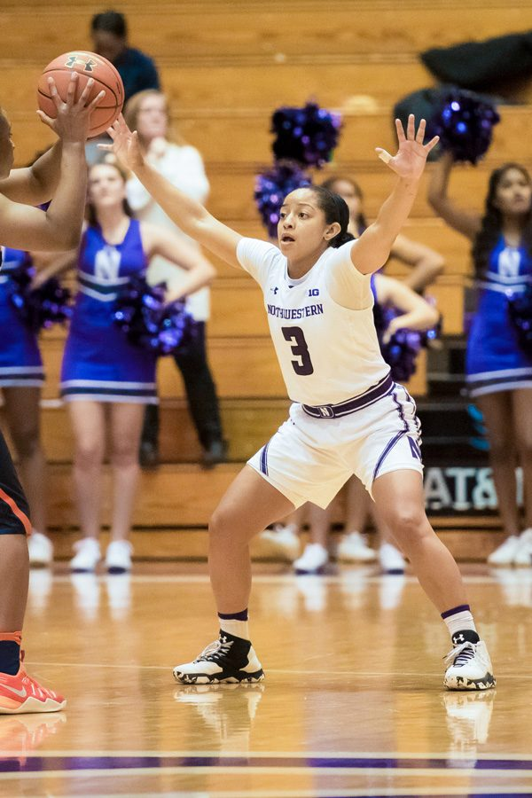 Ashley+Deary+defends+an+opponent.+The+senior+tallied+five+steals+as+Northwestern%E2%80%99s+defense+led+it+to+victory.