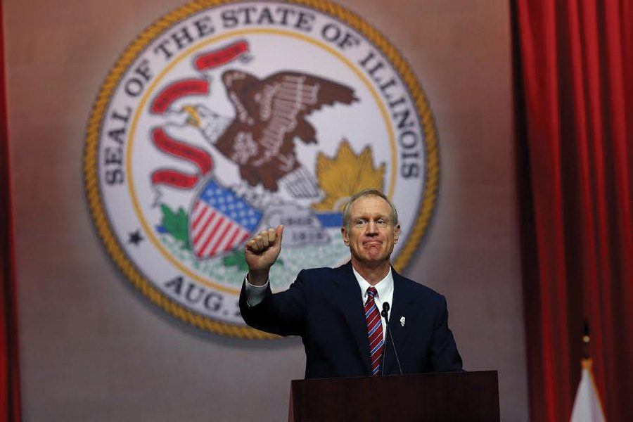 Gov.+Bruce+Rauner+after+his+first+address+as+governor+in+2015.+Rauner+urged+bipartisan+action+in+his+%E2%80%9CState+of+the+State%E2%80%9D+address+on+Wednesday.+