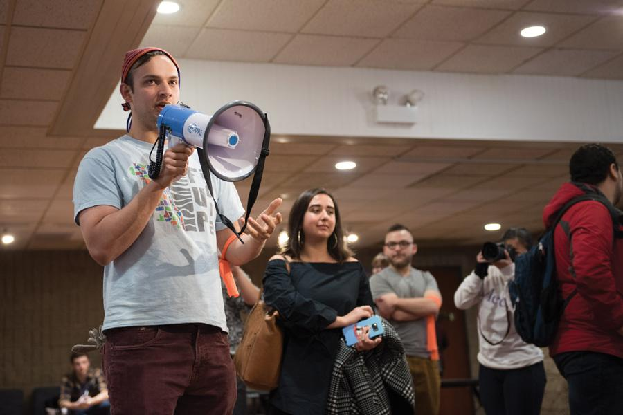 (Allie Goulding/The Daily Northwestern) Zane Waxman (SESP '16) addresses a group of students at Norris University Center on Friday. Student Action NU organized the protest in response to the presidential inauguration of Donald Trump.