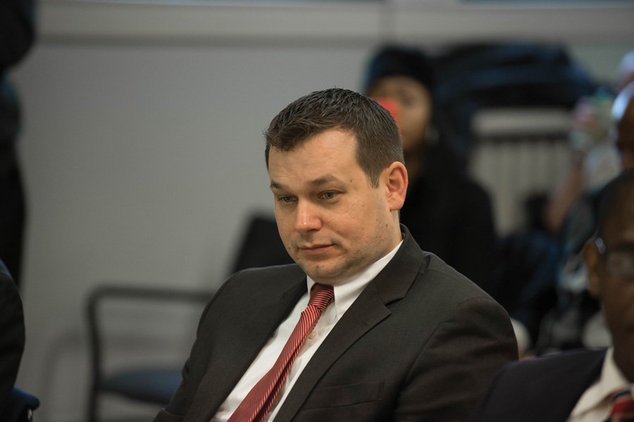 Ald. Brian Miller (9th) attends a city meeting. Miller, a mayoral candidate, pressed for the release of a 2015 video depicting the arrest of Northwestern graduate student Lawrence Crosby, which the city said it will publish online Wednesday.
