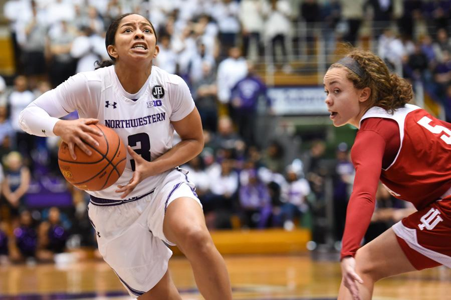 Ashley Deary handles the ball. The senior guard will look to lead the NU backcourt against Michigan's Katelynn Flaherty.