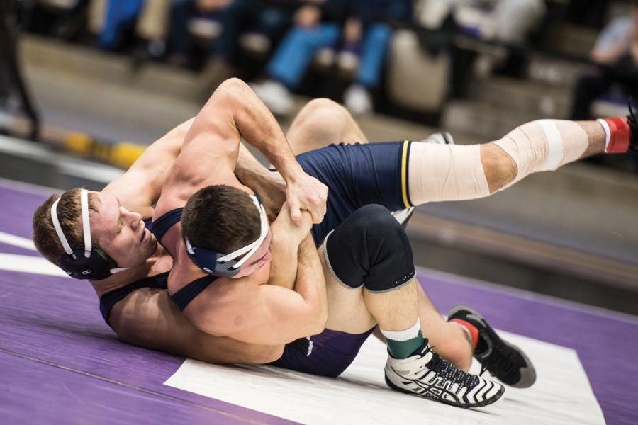 Mitch Sliga wrestles an opponent on the mat. The junior's victory was among the few bright spots in Northwestern's loss to Michigan.