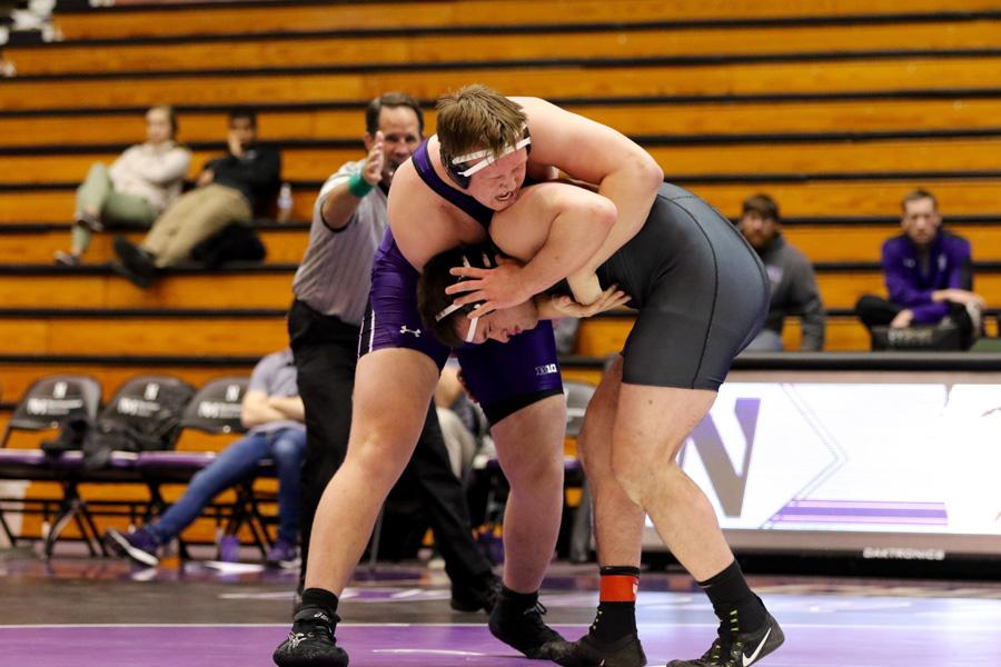 Conan Jennings grapples with an opponent. The sophomore's victory Sunday wasn't enough for the Wildcats.