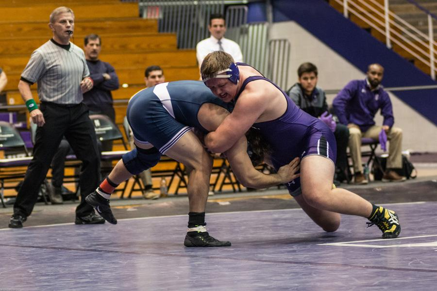 (Daily file photo by Leeks Lim) Conan Jennings wrestles an opponent. The sophomore heavyweight secured Northwestern's comeback against Michigan State on Friday.
