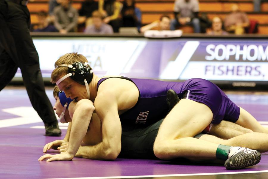 Mitch Sliga pins an opponent. The junior will look to lead his team against a Michigan lineup headlined by a former teammate.