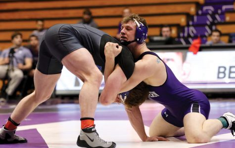 (Daily file photo by Keshia Johnson) Jacob Berkowitz grapples with an opponent. The senior has emerged as a key wrestler for NU this season.