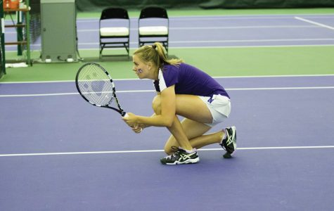 Erin Larner kneels before a point. The junior will look to lead Northwestern through a packed weekend in Durham.