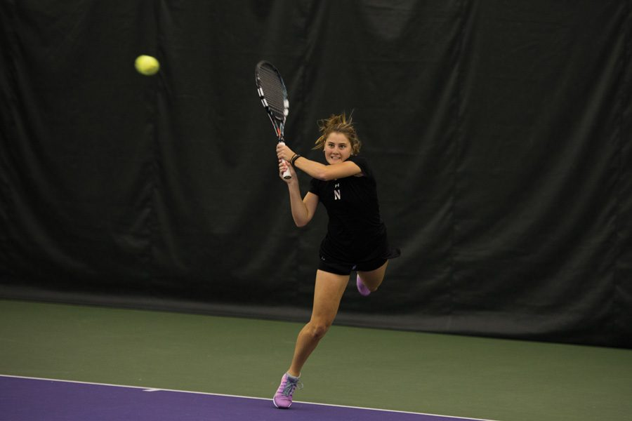 Brooke+Rischbieth+hits+a+backhand.+The+senior+helped+NU+beat+Harvard+on+Sunday+with+her+strong+singles+play.