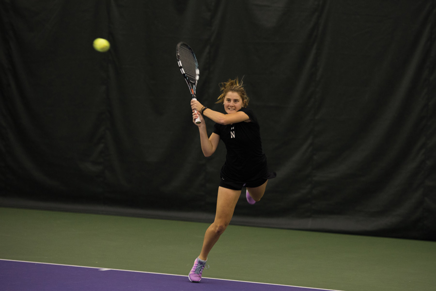 Brooke Rischbieth hits a backhand. The senior helped NU beat Harvard on Sunday with her strong singles play.