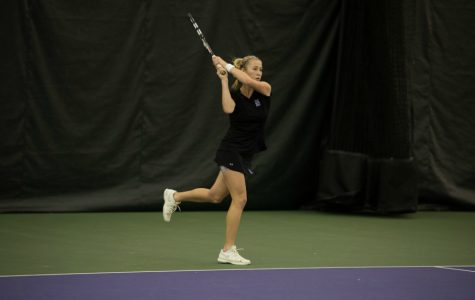 Maddie Lipp follows through a backhand. The junior's tiebreak loss to Duke solidified the Wildcats' loss Sunday.