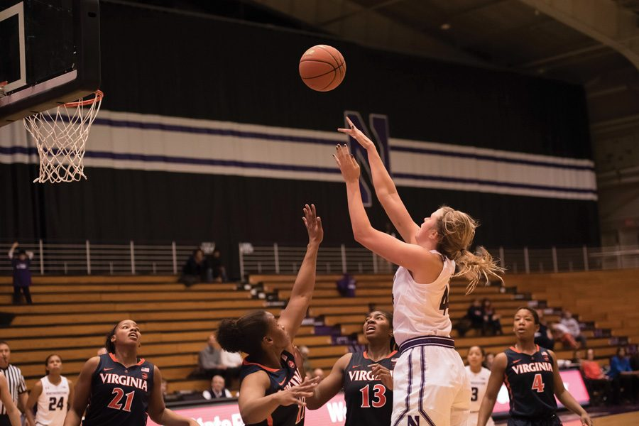 Abi Scheid attempts a shot. The freshman scored a career-best 20 points off the bench Tuesday.