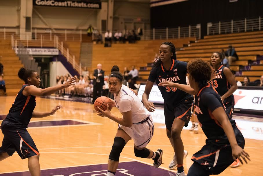 Nia Coffey drives through the paint. The senior made conference history but couldn't lift NU over Maryland on Saturday.