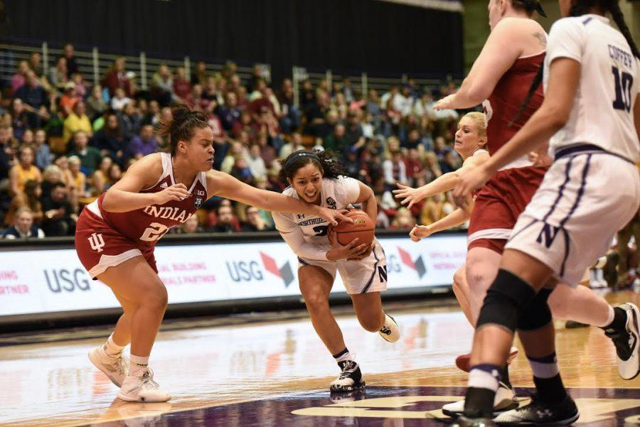 Ashley Deary drives through defenders. The senior guard brought veteran leadership to a shorthanded Northwestern lineup Tuesday.