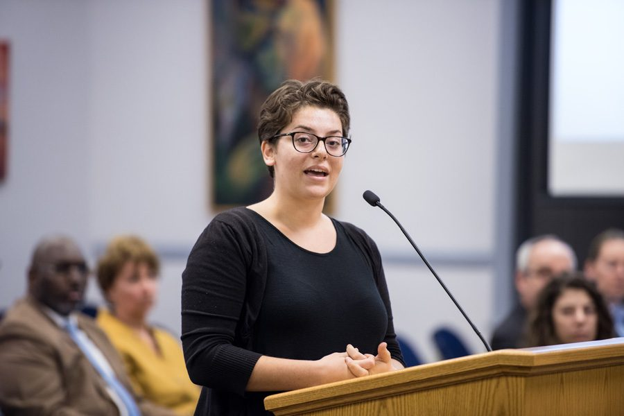 (Daily file photo by Colin Boyle) Associated Student Government President Christina Cilento addresses aldermen, the mayor and city staff in October. ASG held a community dialogue in November on a proposed social inequalities and diversity course requirement.