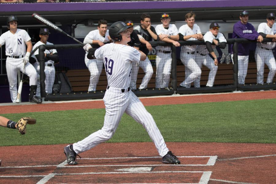 Matt Hopfner follows through a swing. The senior's grand slam was enough for Northwestern in its winless weekend.
