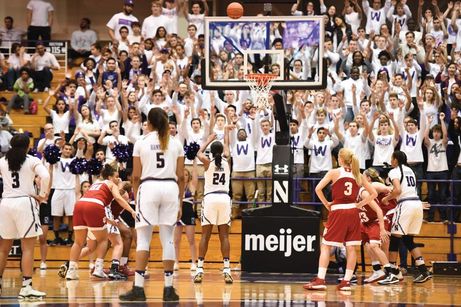 Northwestern fans cheer on Christen Inman as she attempts a foul shot. The Wildcats need to finish the season strong to secure a tournament bid.