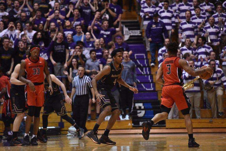 Sophomore forward Vic Law defends. Coach Chris Collins credited the crowd at Welsh-Ryan Arena for feeding his team's defense late in its win over Rutgers.