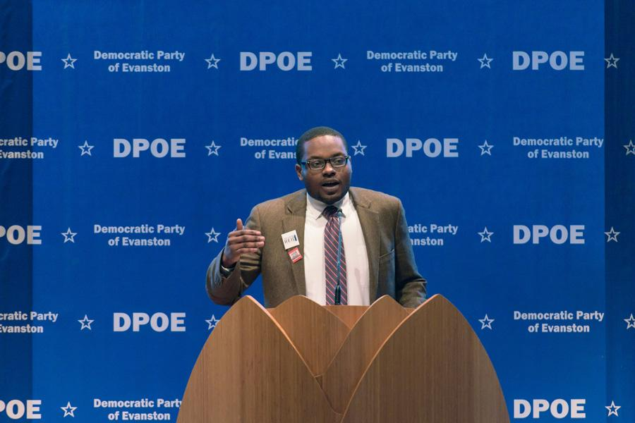 City clerk candidate Devon Reid speaks at the Democratic Party of Evanston's endorsement meeting on Sunday. DPOE members voted to endorse Reid at the meeting.