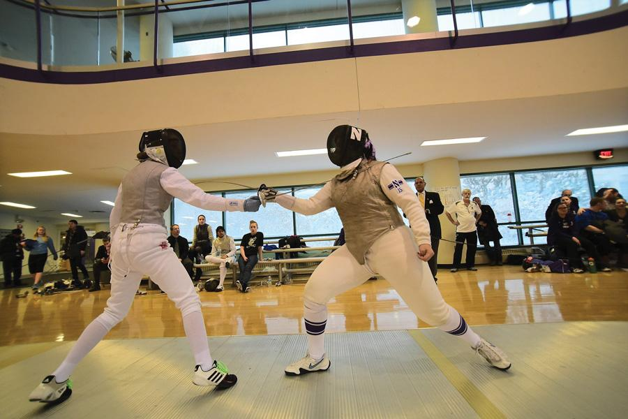 Senior Kimmy Fishman fences against an opponent. Fishman is one of 11 seniors for NU, which hosted its Senior Day in South Bend this weekend.