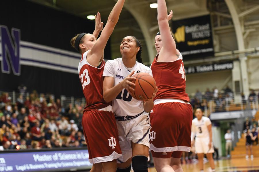 Nia Coffey fights through defenders. The senior forward's big game wasn't enough to lift Northwestern over Penn State on Sunday.