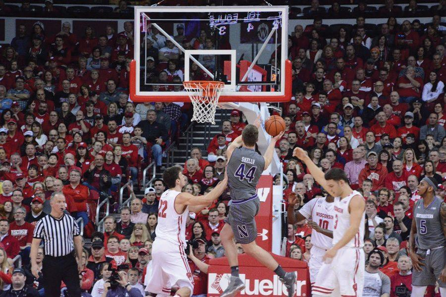 Gavin+Skelly+rises+for+a+layup.+The+junior+forward+and+the+Wildcats+secured+a+huge+win+Sunday+at+No.+7+Wisconsin.