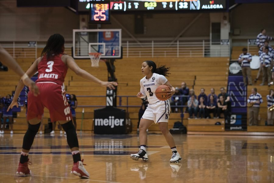 Ashley+Deary+dribbles+the+ball.+The+senior+guard+finished+Thursday%27s+contest+with+12+points%2C+six+assists+and+five+steals+but+couldn%27t+lead+Northwestern+to+victory.