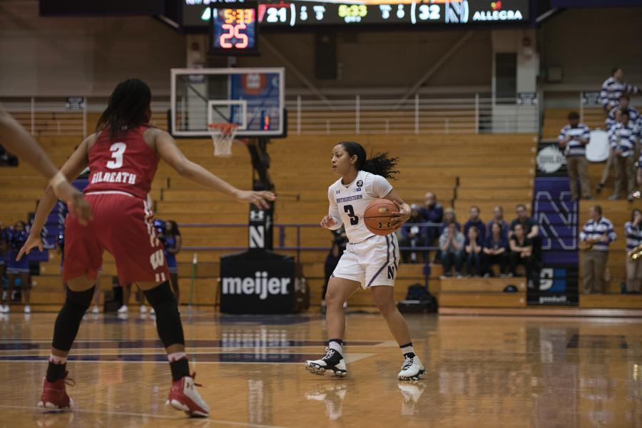 Ashley Deary dribbles the ball. The senior guard finished Thursday's contest with 12 points, six assists and five steals but couldn't lead Northwestern to victory.
