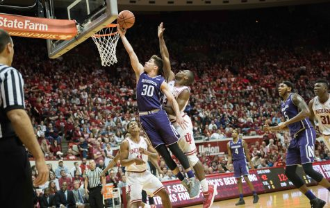 Bryant McIntosh attempts a layup. The junior guard's 22 points weren't enough for Northwestern in its loss to Indiana on Saturday.