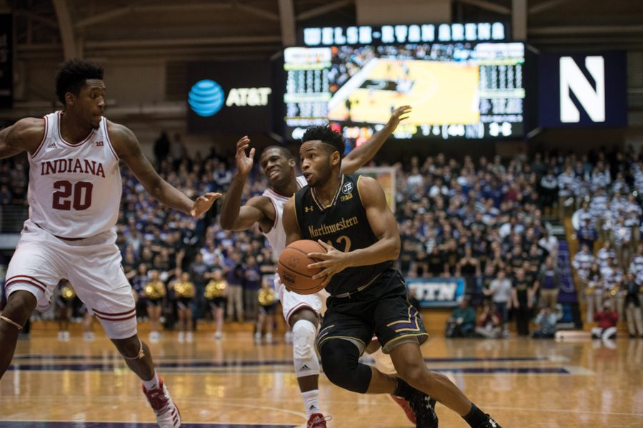Isiah Brown drives past Indiana defenders. The freshman has shown flashes of promise in his rocky start at Northwestern.