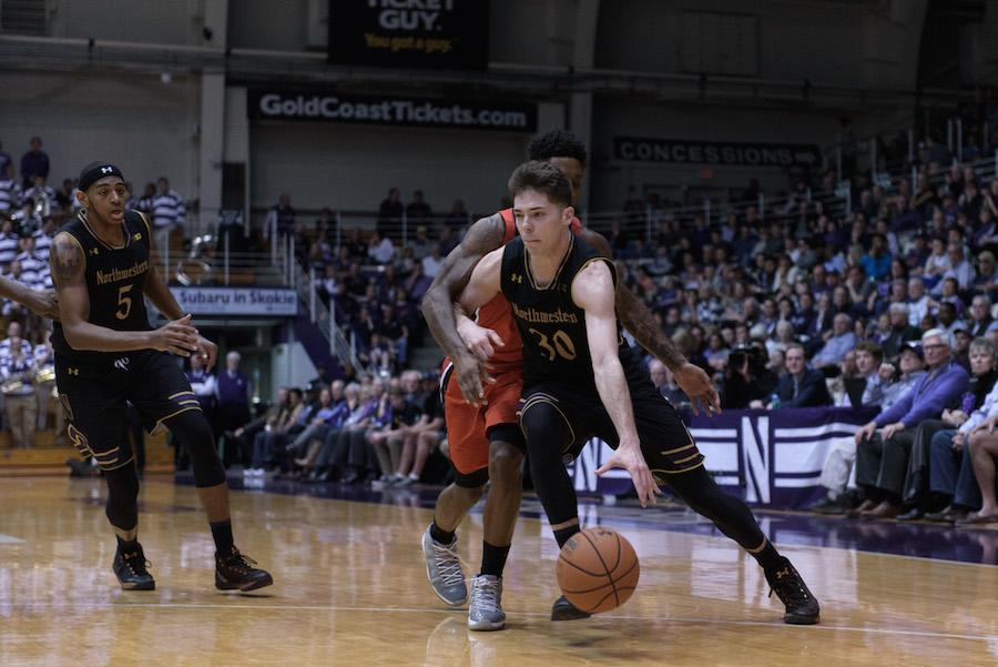 Bryant McIntosh drives past a defender. The junior guard led Northwestern with 16 points against Illinois.