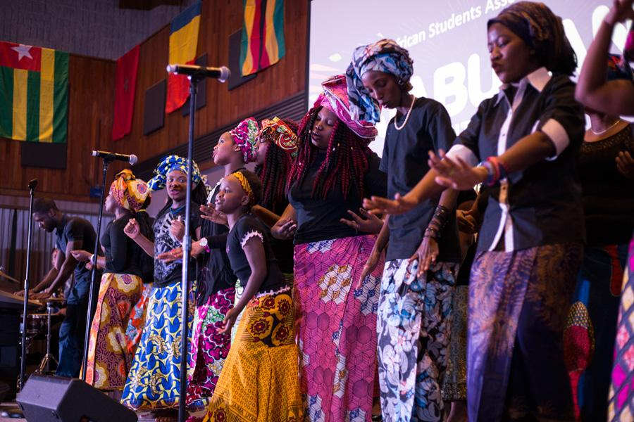 Dancers celebrate African culture on stage at Norris University Center. Jabulani's Culture Show, presented by the African Student's Association, showcased traditional African fashion and dance.