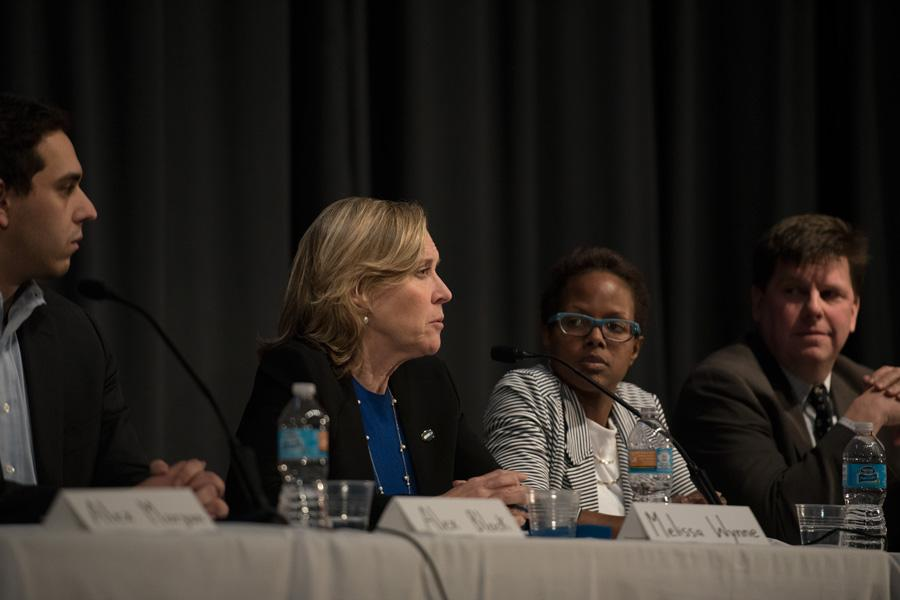 Ald. Melissa Wynne (3rd) speaks Tuesday at a candidate forum. Last week, Wynne defended the Economic Development Committee's decision to deny a $50,000 storefront modernization grant to the owner of Kabul House, 2424 Dempster St.