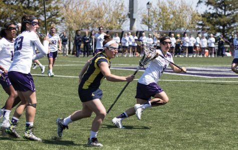 Christina Esposito runs past an opponent. The senior scored four goals in Northwestern's loss to Colorado.
