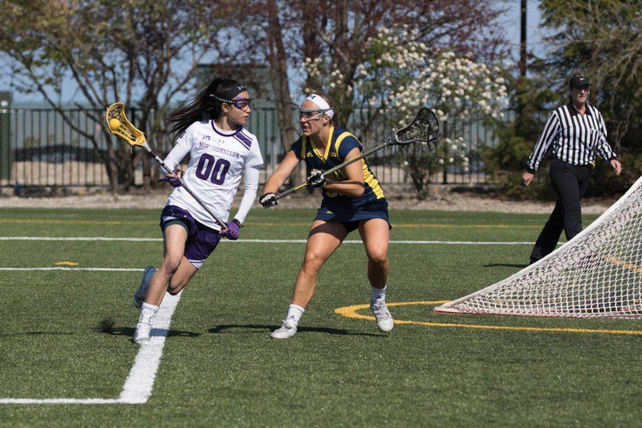 Corinne Wessels runs with the ball. The junior attacker has helped guide Northwestern's offense from behind the net this season.