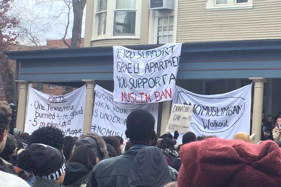 "Members of the Northwestern community join a demonstration at the Multicultural Center in opposition to President Trump's travel ban. One of the signs hanging on the center read, ""If you support Israeli apartheid you support a Muslim ban."""