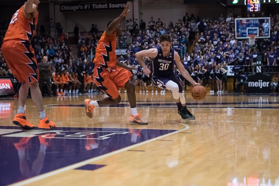 Bryant McIntosh turns the corner on a defender. The junior guard and Northwestern dropped a home game to No. 23 Maryland on Wednesday.